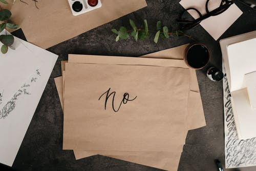 """No"" written on paper. Cottonbro at pexels.com"