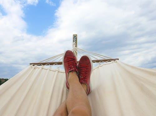 feet on hammock; image by Mateusz Each; Pexels